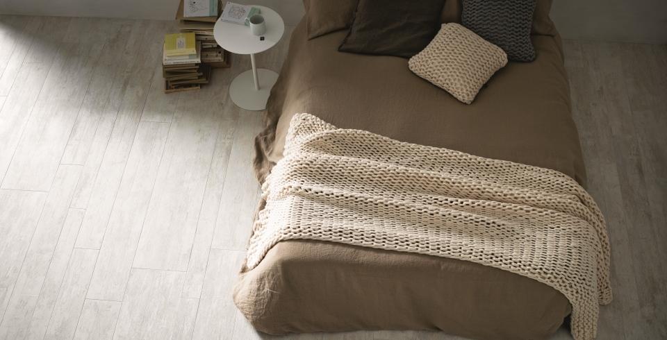 Im Schlafzimmer findet man ebenfalls Holzoptik Fliesenböden
