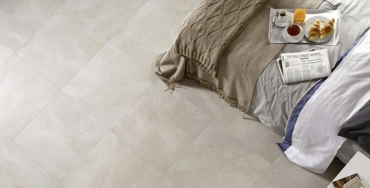 helle betonoptikfliese im schlafbereich